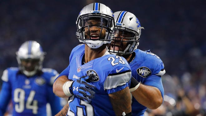 Detroit Lions cornerback Darius Slay (23) is hugged by defensive tackle Haloti Ngata (92) after his interception during the second half of an NFL football game against the Minnesota Vikings, Thursday, Nov. 24, 2016 in Detroit.