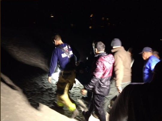 BCFR personnel attend to a dolphin on the beach in