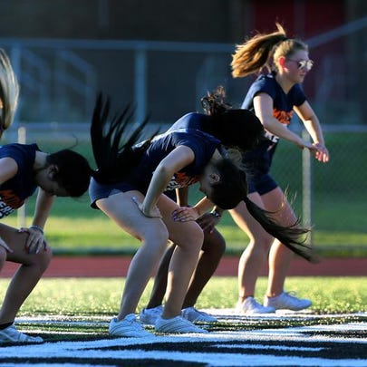 The Middlesex County All-Star cheerleading squad practices