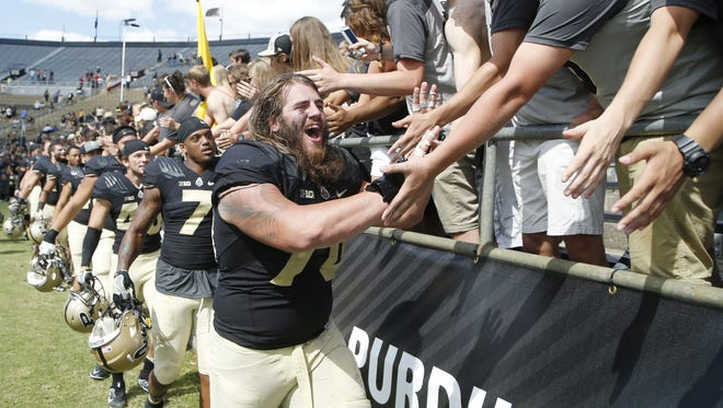Jordan Roos celebrates with Purdue students after the Boilermakers defeated Eastern Kentucky 45-24 on Saturday, September 3, 2016, at Ross-Ade Stadium.