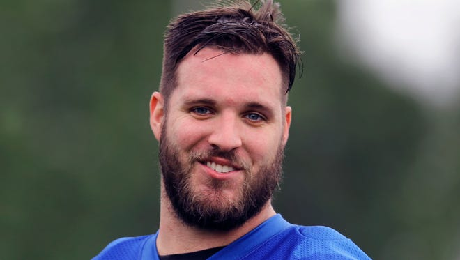 FILE - In this May 24, 2017, file photo, Detroit Lions offensive tackle Taylor Decker watches during an NFL football practice in Allen Park, Mich.  Decker returned to practice Wednesday, Nov. 1, 2017, and was taken off the physically unable to perform list. He hurt his right shoulder during an offseason workout with the team and had surgery in June.