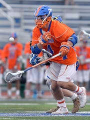 Penn Yan's Austin Fingar wins the ball off a faceoff.