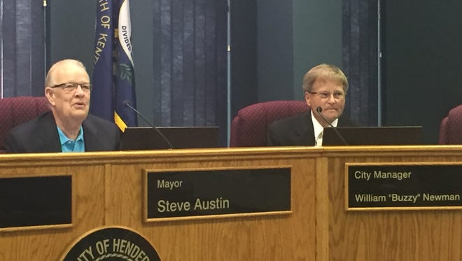 """City Manager William """"Buzzy"""" Newman, at right, and Mayor Steve Austin take part in a Henderson City Commission meeting in this file photo."""