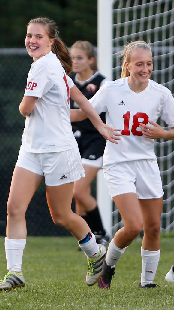 West Lafayette's Anneliese Givan, left, celebrates with Katy Penquite after her goal at 34:58 in the second half put the Red Devils up 4-0 over Lafayette Jeff Tuesday, September 5, 2017, in West Lafayette. The Red Devils pounded the Bronchos 6-1.
