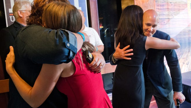 Brian Mast is congratulated by his sister, Shawn Ramseur of Chattanooga, Tenn., who drove down to surprise him at his victory party at the former Spoto's Oyster Bar Tuesday, Nov. 8, 2016, in downtown Stuart. Mast defeated Randy Perkins in Florida's 18th Congressional District race.  To see more photos, go to TCPalm.com