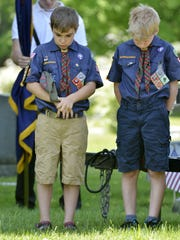 Spencer Levi, 10, left, and Jordan Wood, 10, both of Jericho, bow their heads as a blessing is given at Jericho's Memorial Day ceremony in Pleasant View Cemetery in 2016. Both boys are members of the Cub Scouts Pack 620.