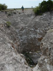 A karst-formed sinkhole that funnels water into Eddy County's underground aquifers.