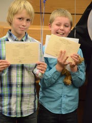 Tyler, 11, and Jacob, 9, Kendrick were adopted Tuesday.