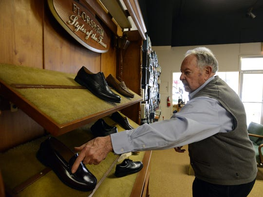 Jim Johnson gets a pair of shoes for a customer Monday at Johnson's Shoes in downtown Lancaster. Johnson, the store's owner, is retiring next month and plans to close the store. The 89-year-old has worked at the store since 1956.