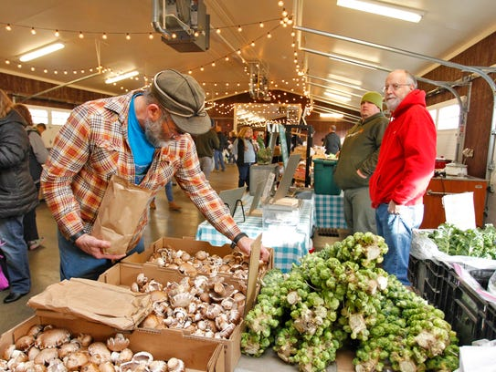 Eric Booth of Whitney Point selects portobello mushrooms