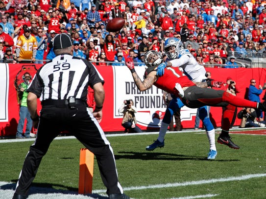 Teez Tabor (30) of the Detroit Lions defends a pass