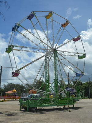 A ferris wheel is among the carnival rides set up at the parking lot of the Paseo de Susana in Hagåtña on June 26, 2017.