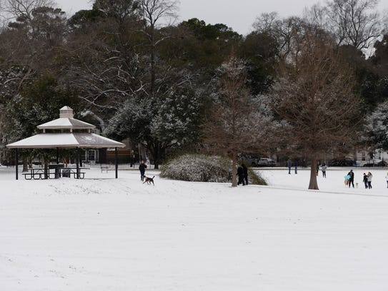 Snow covers the ground at Betty Virginia Park in Shreveport,