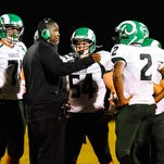 Parkside offensive coordinator Allen Mitchell speaks to his team at halftime against the North Caroline Bulldogs on Friday night in Ridgely, Maryland.