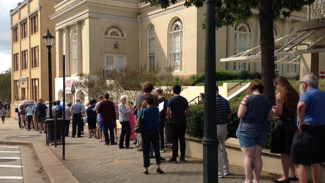 A line forms outside the Athens-Clarke County Board of Elections office in downtown Athens during early voting.