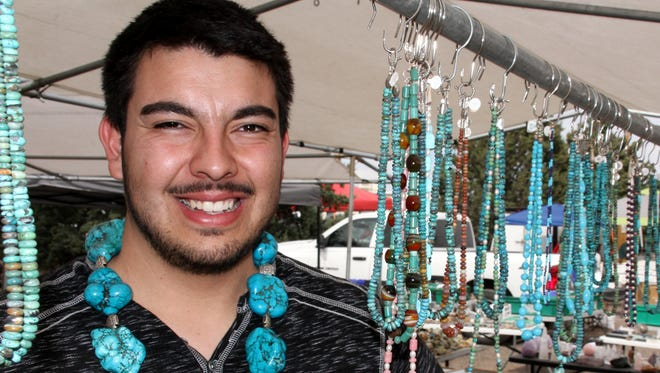 Alex Montano, of Santa Fe Silver Moon, had a steady flow of interested rock collectors and curious customers.