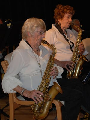 Saxophone players Maggie Kennedy and Pat Murchison are among the fine musicians who gather each week to play for the love of music.