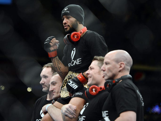 Demetrious Johnson celebrates after defeating Joseph Benavidez during the flyweight championship bout of the UFC on FOX 9 at Sleep Train Arena.