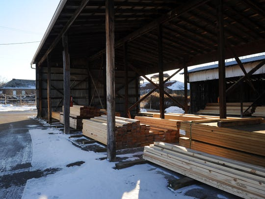 Lumber storage houses are shown at Higgins Lumber Company in Roseville.