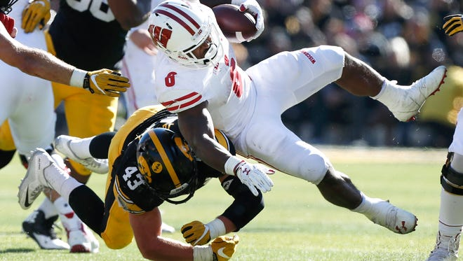 Wisconsin running back Corey Clement is tackled by Iowa linebacker Josey Jewell during the second half.