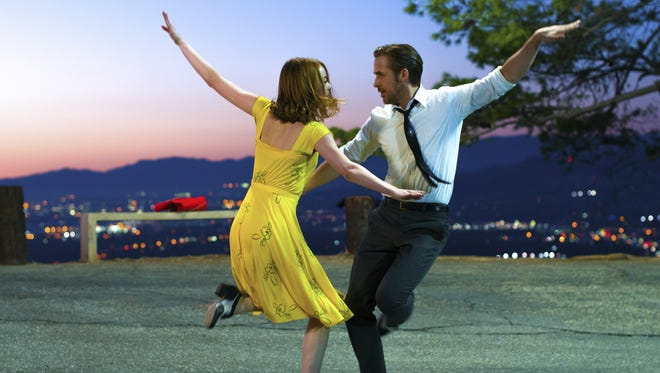 "Ryan Gosling and Emma Stone appear in a scene from ""La La Land."""