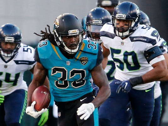 FILE - In this Dec. 10, 2017, file photo, Jacksonville Jaguars running back Chris Ivory (33) runs against the Seattle Seahawks during the first half of an NFL football game in Jacksonville, Fla. Chris Ivory has agreed to sign a two-year contract with the Buffalo Bills oM tuesday, March 6, 2018, where the eighth-year player will have an opportunity to serve as LeSean McCoy's primary backup. (AP Photo/Stephen B. Morton, File)