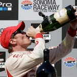 SONOMA, CA - AUGUST 24:  Scott Dixon of New Zealand, driver of the #9 Target Chip Ganassi Racing Chevrolet, celebrates after winning the Verizon IndyCar Series GoPro Grand Prix of Sonoma at Sonoma Raceway on August 24, 2014 in Sonoma, California.