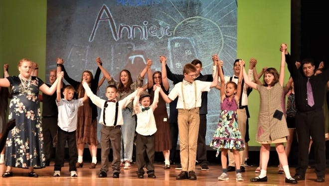 "The cast of the Penguin Project production of ""Annie Jr."" during dress rehearsals."