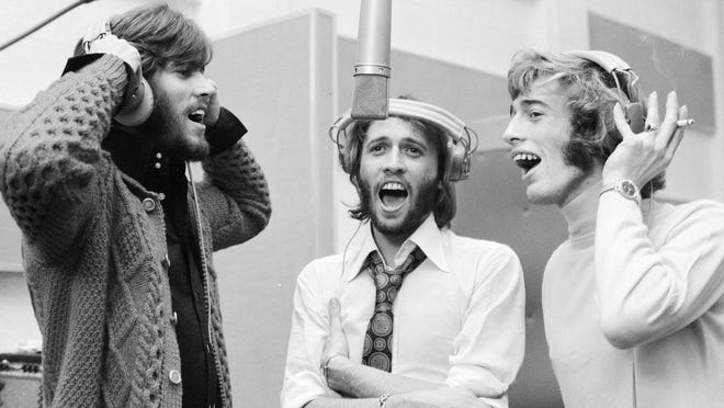 Barry, Maurice, and Robin Gibb reunite in the studio in 1970.