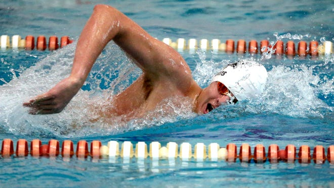 Ben Davis of Greenfield Co-op wins the 1000-yard freestyle with a time of 10:08.58 during the Metro Swim Official Invite at Homestead High School on Thursday.