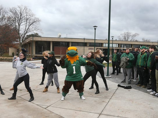 The Brockport dance team performs during a pep rally at the mall of the SUNY campus. The rally was to cheer on the Golden Eagles football team (right) which will host an NCAA game at noon on Saturday.