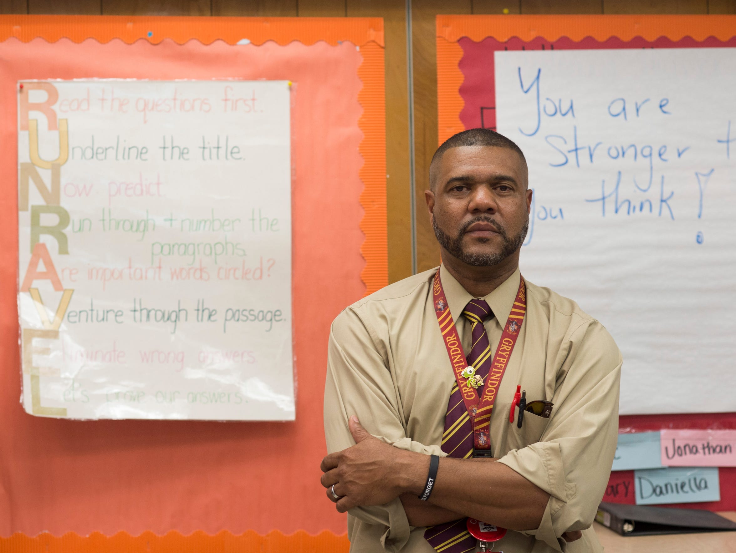 "Apollo Elementary School fourth-grade teacher Jonathan Hilliard, seen May 4 in his classroom in Titusville, says his biggest worry for the state of Florida is the environment. ""We're such a beautiful topography, geography, but I don't think we're good stewards of our land,"" Hilliard said. ""You know, our river, our lagoon is being polluted. We see eagles, dolphins, manatees. If we're not good stewards, eventually my grandchildren or my great-grandchildren might not see these animals for much longer."""