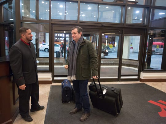 Republican presidential candidate Sen. Ted Cruz, R-Texas arrives at the downtown Des Moines Marriott after a day of campaigning at 11:47 p.m. Tuesday, Jan. 26, 2016.