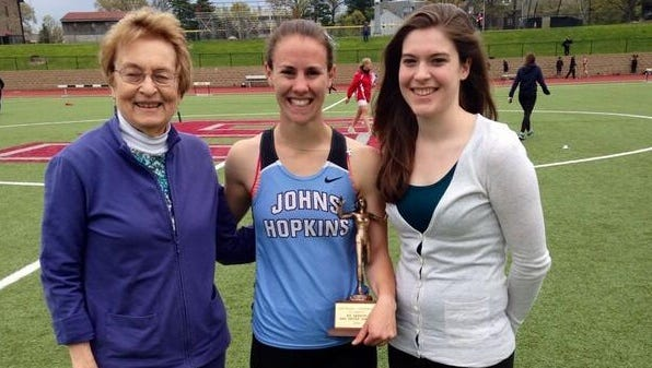 Roberson graduate Megan McDonald, center, is a junior on the Johns Hopkins women's track team.