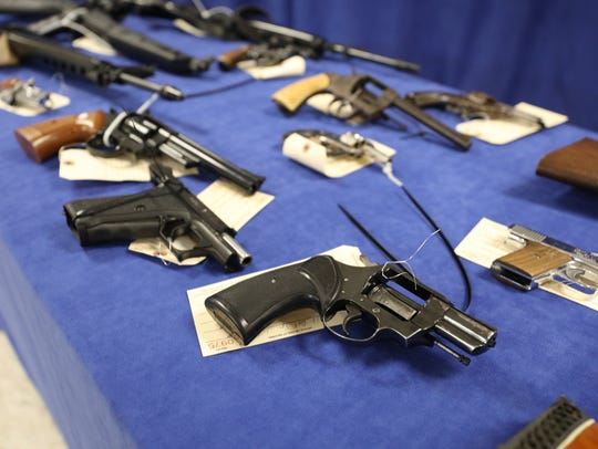 Various guns are displayed during the gun buyback program
