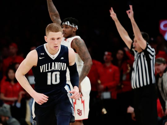 Villanova's Donte DiVincenzo (10) reacts after making a 3-point basket during the second half of the team's NCAA college basketball game against St. John's on Saturday, Jan. 13, 2018, in New York. Villanova won 78-71. (AP Photo/Frank Franklin II)