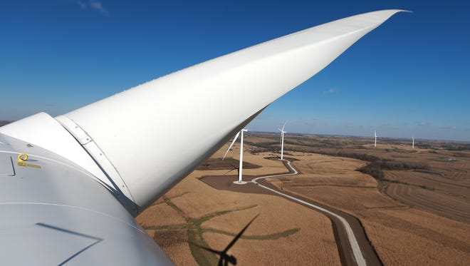 Turbines line the Madison County countryside as seen from the top of a wind turbine in rural Macksburg.