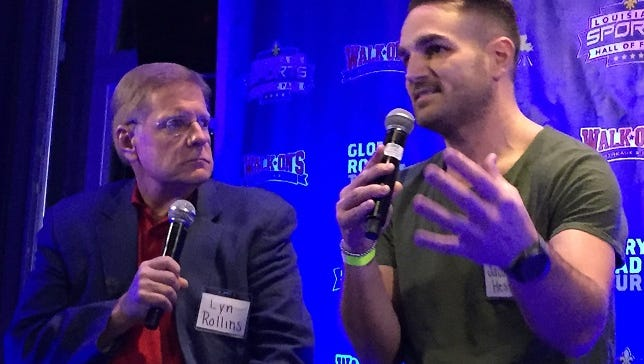 Former Evangel, LSU and San Diego standout Jacob Hester makes a point to Lyn Rollins Tuesday at the Louisiana Sports Hall of Fame Glory Road Tour.