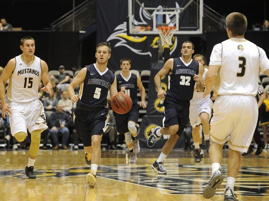 Augustana's #5 Tanner Odegaard brings the basketball down the court against SMSU during basketball action at the Arena in Sioux Falls, S.D., Sunday, Jan. 3, 2016.