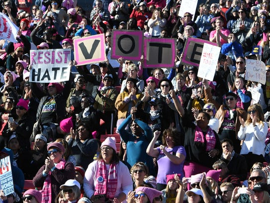 """Demonstrators attend the Women's March """"Power to the"""