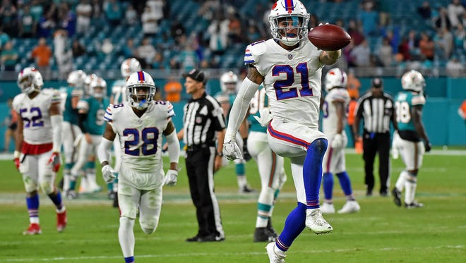 Buffalo Bills free safety Jordan Poyer (21) celebrates after intercepting a pass from Miami Dolphins quarterback David Fales (9) during the second half at Hard Rock Stadium.