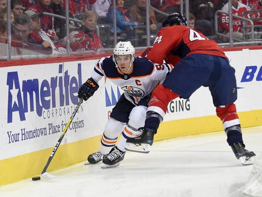 Edmonton Oilers center Connor McDavid (97) skates with the puck against Washington Capitals defenseman Brooks Orpik (44) during the first period of an NHL hockey game, Sunday, Nov. 12, 2017, in Washington. (AP Photo/Nick Wass)