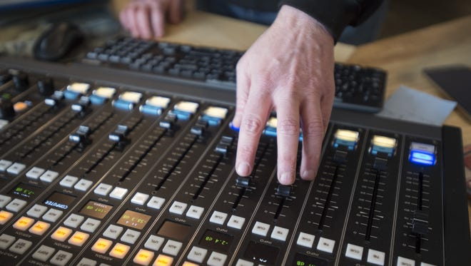 "Jon Bard or ""Brother JB"" adjusts the sound board during his show, ""The Wild Ride,"" on KRFC Public Radio on Friday, March 10, 2017. The community radio station has moved into its new home at The Music District on College Avenue."