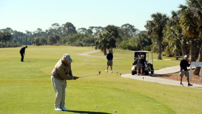 """Jim Culver chips a few golf balls near the first tee box of the Dunes Course at Sandridge Golf Club in Vero Beach on Thursday, March 15, 2018. Culver and a group of 30 to 40 people from Sea Oaks Beach and Tennis Club play golf at Sandridge every Tuesday and Thursday because of the quality of the courses and the friendly staff. """"Sandridge is just a terrific golf course and is one of the best on the Treasure Coast,"""" Culver said. """"You get two courses, a practice facility, you've got instruction, they have clinics. It's all here."""" Over the past few years, Florida municipal golf courses have lost tens of millions of dollars and Sandridge remains one of only a handful that are profitable."""