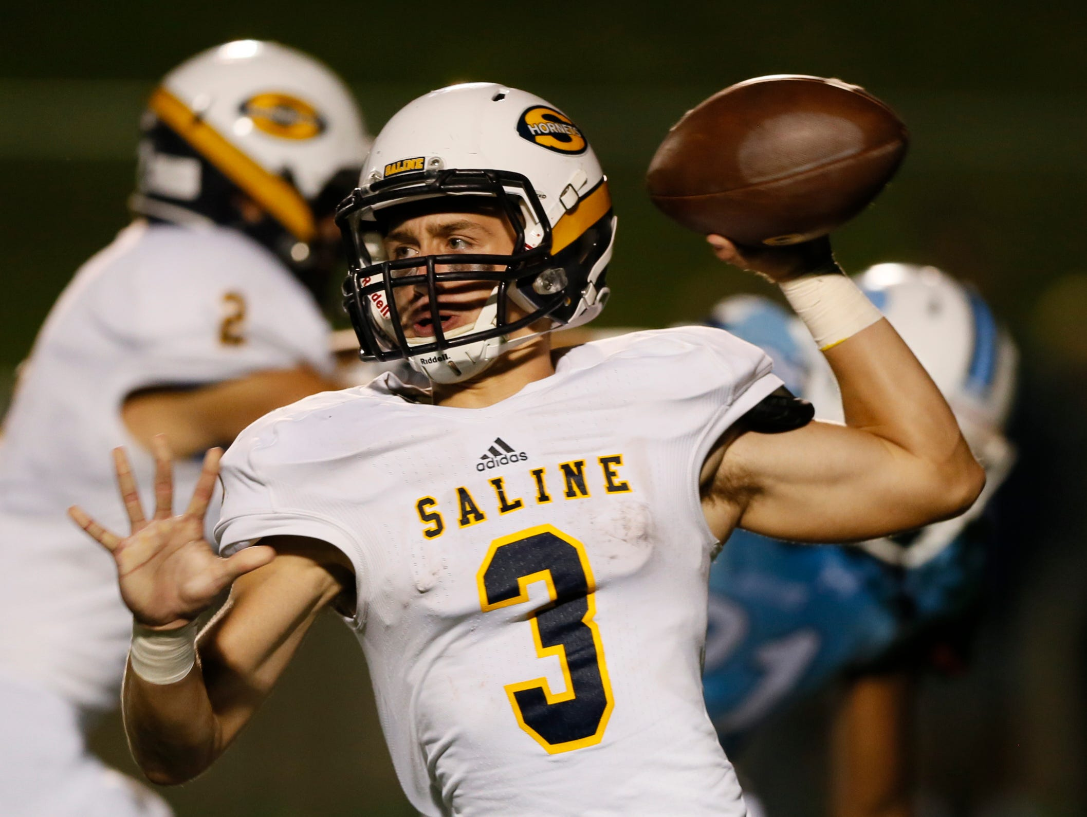 Saline's Zach Schwartzenberger comes in to play quarterback late in the third quarter against Ann Arbor Skyline on Sept. 11, 2015. Saline won 45-6.
