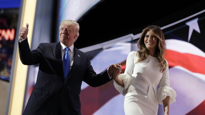 Donald Trump walks off the stage Monday night with his wife, Melania, after she spoke at the GOP convention. A segment of her speech was similar to remarks by Michelle Obama at the 2008 Democratic convention.