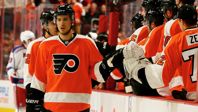 Michael Del Zotto (foreground) and Luke Schenn (behind Del Zotto) aim to prove their critics wrong this season.