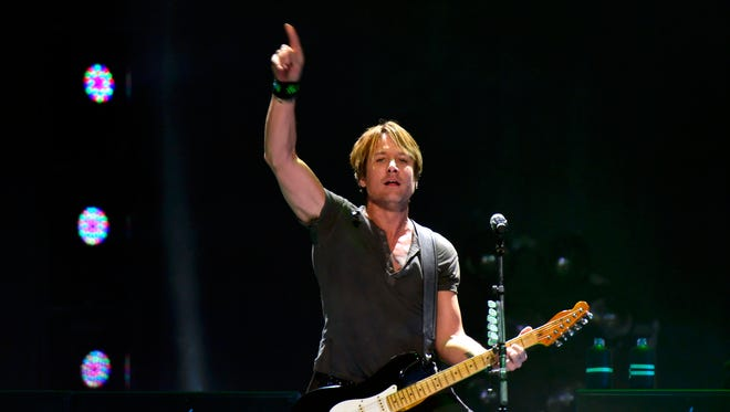 Keith Urban performs in 2013 at the KFC Yum Center. Michael Dossett/Special to The Courier-Journal