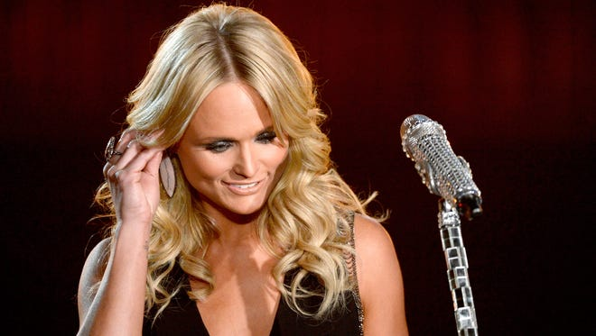 LOS ANGELES, CA - JANUARY 26:  Musician Miranda Lambert performs onstage during the 56th GRAMMY Awards at Staples Center on January 26, 2014 in Los Angeles, California.