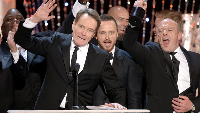 (L-R) Bryan Cranston, Aaron Paul and Dean Norris accept the Outstanding Performance by an Ensemble in a Drama Series award for 'Breaking Bad' onstage during the 20th Annual Screen Actors Guild Awards at The Shrine Auditorium on January 18, 2014 in Los Angeles, California.
